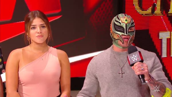 Rey Mysterio and his daughter Aalyah listen to Seth Rollins' reveal the results of a paternity test on WWE Monday Night Raw