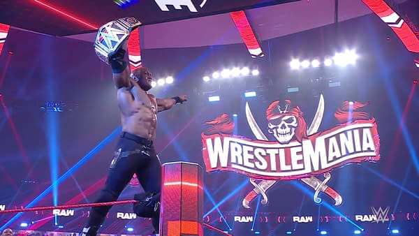 Bobby Lashley holds up his newly-won WWE Championship on an episode of WWE Raw.