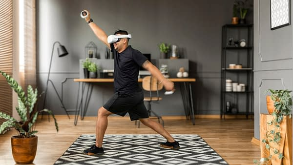 A promotional image of an Oculus user enjoying the interface of VZFit from his own home.