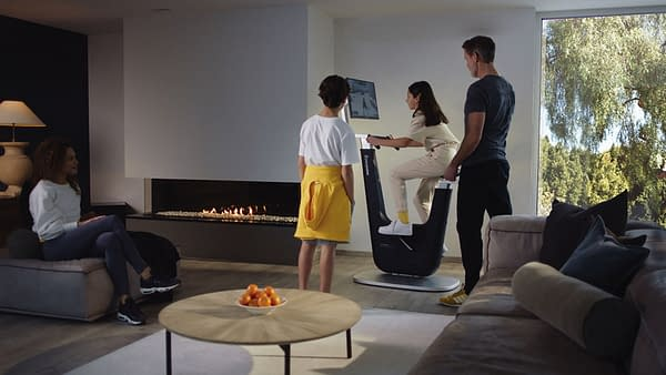 A promotional image of the Playpulse ONE in action at home in the living room.