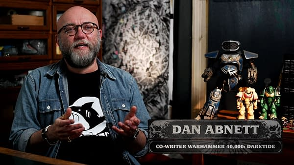 A still of Dan Abnett, author of many Games Workshop novels and co-writer for Warhammer 40,000: Darktide, discussing his inclusion in the project by Fatshark.