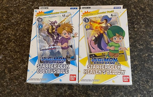 The Cocytus Blue and Heaven's Yellow starter decks from the Digimon Card Game by Bandai. Not pictured: Gaia Red.