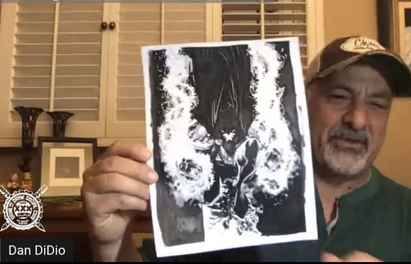 Dan DiDio shows off his artwork - or at least his sharpie inking.
