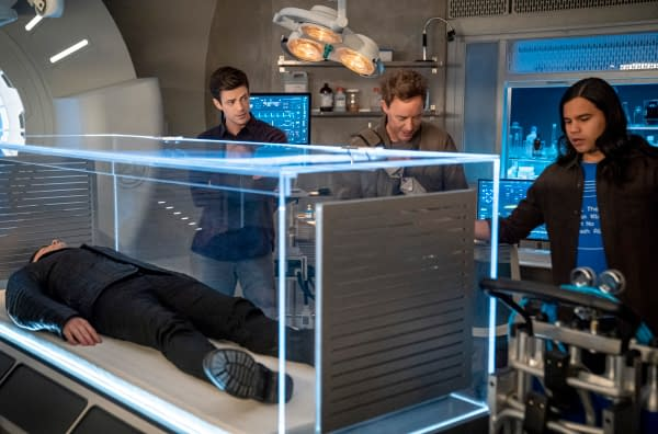 Grant Gustin as Barry Allen, Tom Cavanagh as Nash Wells, and Carlos Valdes as Cisco Ramon in The Flash, courtesy of The CW.