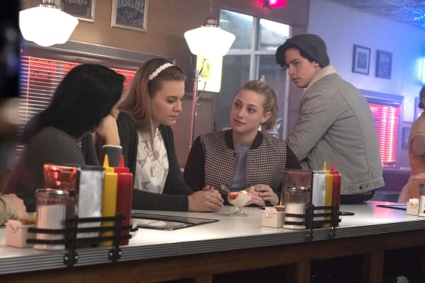"Riverdale -- ""Chapter Seven: In A Lonely Place"" -- Image Number: RVD107a_0319.jpg -- Pictured (L-R): Camila Mendes as Veronica Lodge, Tiera Skovbye as Polly Cooper, Lili Reinhart as Betty Cooper, and Cole Sprouse as Jughead Jones -- Photo: Katie Yu/The CW -- © 2017 The CW Network. All Rights Reserved"