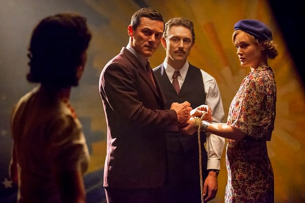 PMWW_02816_R<br /> (l-r.) Rebecca Hall stars as Elizabeth Marston, Luke Evans as Dr. William Marston, JJ Feild as Charles Guyette and Bella Heathcote as Olive Byrne in PROFESSOR MARSTON AND THE WONDER WOMEN, an Annapurna Pictures release.<br /> Credit: Claire Folger / Annapurna Pictures