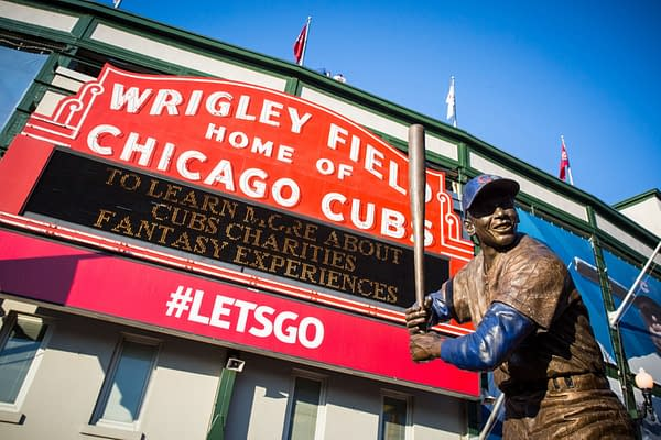 Chicago, USA - August 12, 2015: The famous signage on a warm summer's night at Wrigley Field -- FiledIMAGE/Shutterstock.com