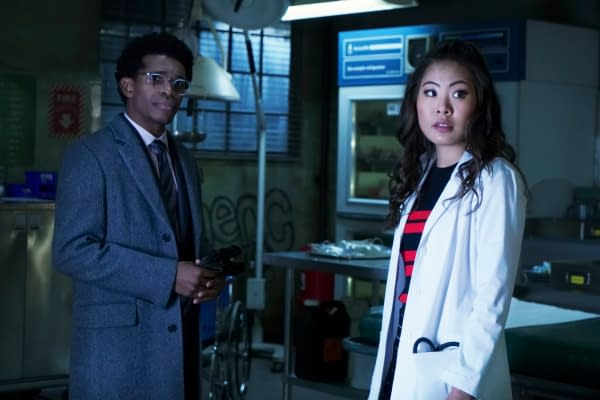 """Batwoman -- """"Off With Her Head"""" -- Image Number: BWN115a_0042b -- Pictured (L-R): Camrus Johnson as Luke Fox and Nicole Kang as Mary Hamilton -- Photo: Shane Harvey/The CW -- © 2020 The CW Network, LLC. All rights reserved."""