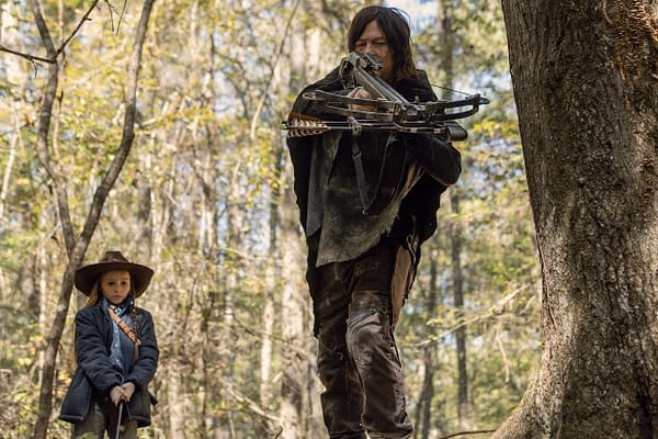 Norman Reedus as Daryl Dixon, Cailey Fleming as Judith Grimes in The Walking Dead, courtesy of AMC Networks.