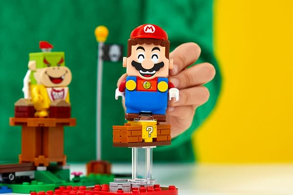 Mario looks so happy in LEGO form, if only he knew he was hackable. Courtesy of Nintendo.