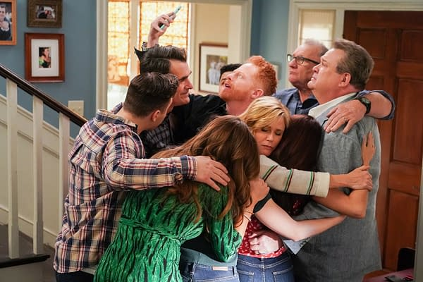 Phil, Mitch, Cam, Claire, Jay, Gloria, and the rest of the family gather for a group hug selfie on Modern Family, courtesy of ABC.