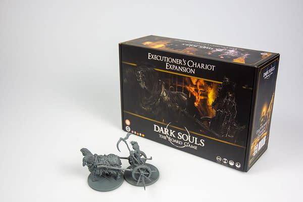 The box for the Executioner's Chariot expansion for the Dark Souls board game by Steamforged Games.