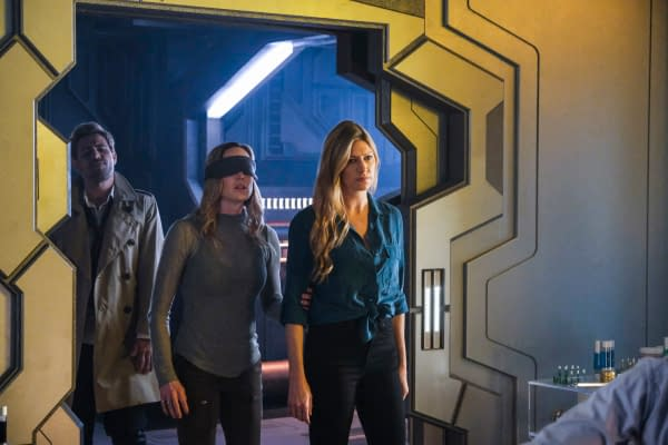 Matt Ryan as Constantine, Caity Lotz as Sara Lance/White Canary, and Jes Macallan as Ava Sharpe on DC's Legends of Tomorrow, courtesy of The CW.