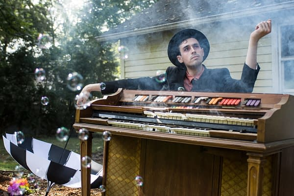 One last glamour shot of Will Wood, this time beside his trusty, totally-functional piano that is not smoking or bubbling at all.