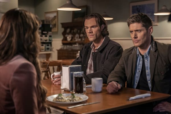 """Supernatural -- """"Gimme Shelter"""" -- Image Number: SN1515B_0504r.jpg -- Pictured (L-R): Emily Swallow as Amara, Jared Padalecki as Sam and Jensen Ackles as Dean -- Photo: Colin Bentley/The CW -- © 2020 The CW Network, LLC. All Rights Reserved."""