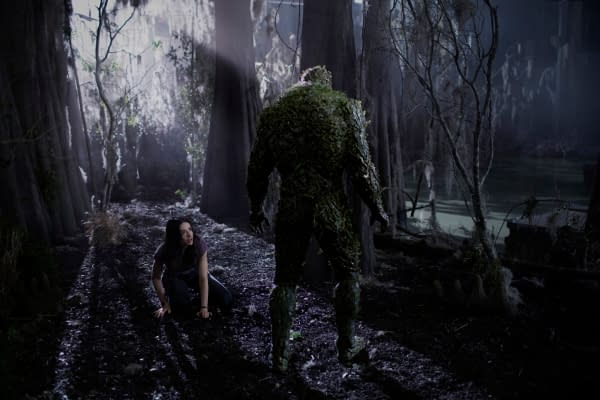 "Swamp Thing -- ""Darkness on the Edge of Town"" -- Image Number: SWP104a_0217r -- Pictured (L -R): Crystal Reed as Dr. Abby Arcane and Derek Mears as Swamp Thing -- Photo: Fred Norris / 2020 Warner Bros. Entertainment Inc. -- © 2020 Warner Bros. Entertainment Inc. All Rights Reserved."