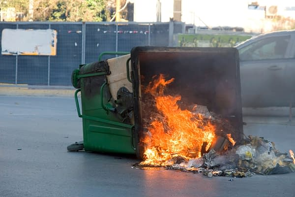 The Official Graphic of The Week in Comics. Fire in a Garbage Bin, photo credit: konstantinos69/shutterstock.com.