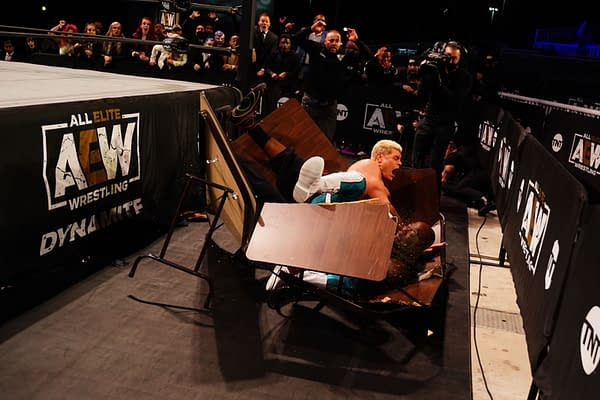 Cody Rhodes crashes through a table with Shaq on AEW Dynamite - Credit: All Elite Wrestling