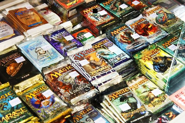 A large pile of sorted, albeit unopened, packs of Magic: The Gathering cards. Source: MIT