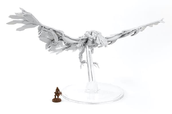 A better look at the render for the Stormbird in its namesake expansion for Horizon: Zero Dawn: The Board Game, by Steamforged Games, with a human figure for scale.