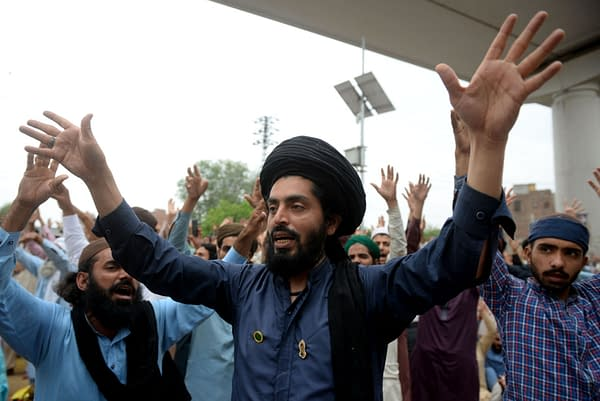 Supporters of the Tehreek-e-Labaik Pakistan (TLP) Islamist political party chant slogans as they protest against the arrest of their leader in Lahore, Pakistan April 16, 2021, photo credit: A M Syed / Shutterstock.com.