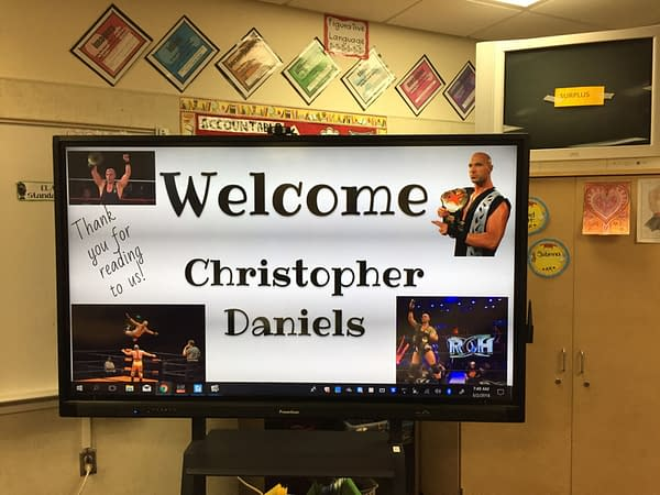 Christopher Daniels read to kids