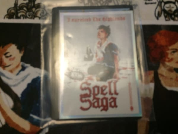 An add-on of promotional cards and a sticker for Spell Saga. Apologies for the blur. (Photo credit: Josh Nelson)