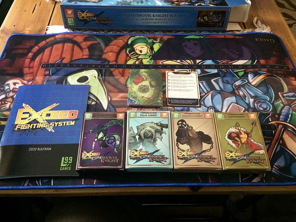 The interior array of components for the Exceed Fighting System's Plague Knight boxed set by Level 99 Games.