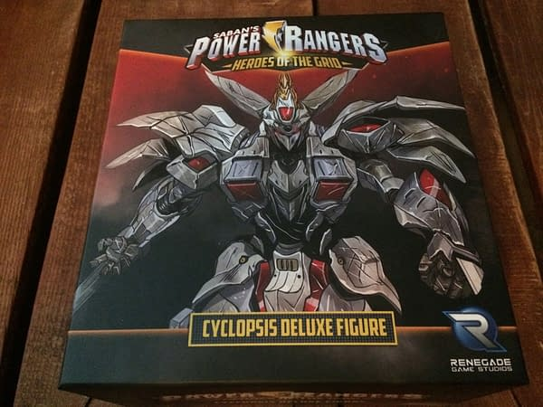 The front lid of the box for the Cyclopsis deluxe figure from Renegade Game Studios' Power Rangers: Heroes of the Grid board game.