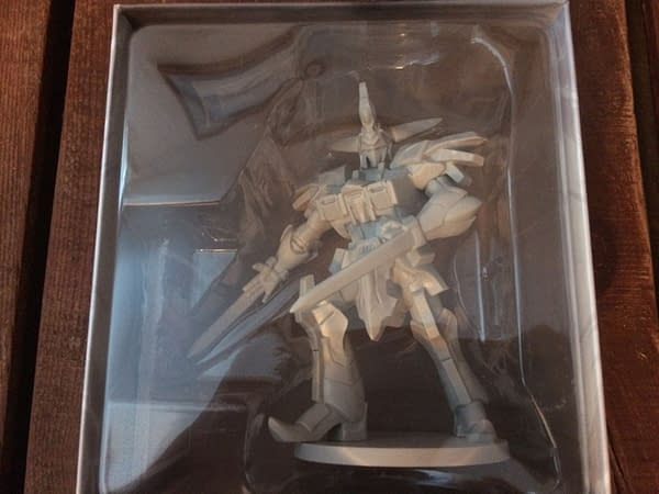 The Cyclopsis deluxe figure for Renegade's Power Rangers: Heroes of the Grid, in its box behind plastic. It is definitely larger and more dynamic than the original Megazord figure.