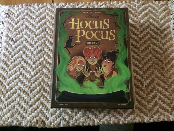 The front of the Hocus Pocus board game by Ravensburger, showing the Sanderson sisters as they cast a wicked spell. Photo credit: Josh Nelson