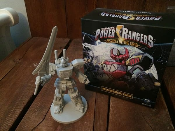 The Megazord deluxe figure from Power Rangers: Heroes of the Grid, out of its box and with Power Sword in hand.