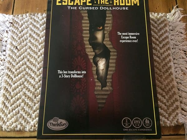 The front lid of the box for Escape The Room: The Cursed Dollhouse by ThinkFun Inc., out this Fall!