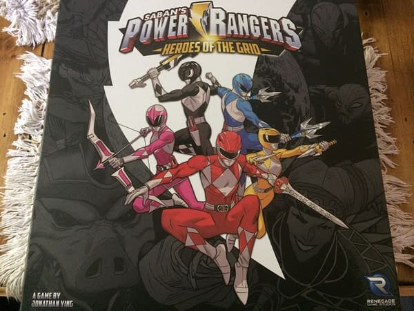 The front lid for the Power Rangers: Heroes of the Grid board game's core game by Renegade Game Studios.