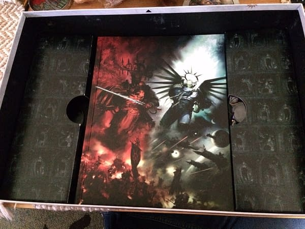 The rulebook for Warhammer 40,000's ninth edition by Games Workshop, bound in exquisite hardcover.