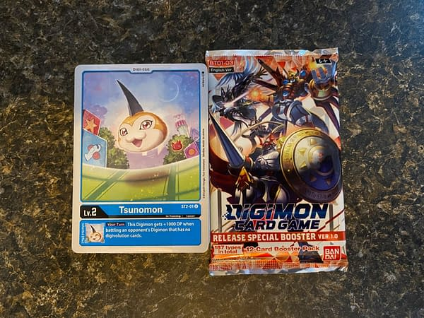 EachDigimon Card Game starter deck in the 1.0 release comes with a booster pack, too!