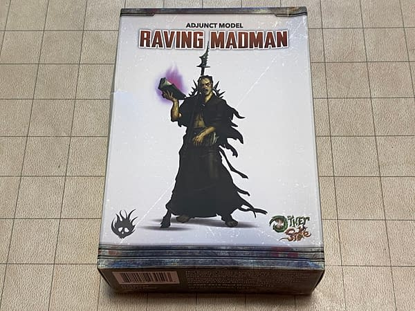The front of the box for the Raving Madman, an adjunct model in Wyrd Miniatures' wargame The Other Side.
