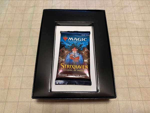 The inside of the Strixhaven: School of Mages collector booster box for Magic: The Gathering. Inside is only one pack and a bit of cardboard to contain it.