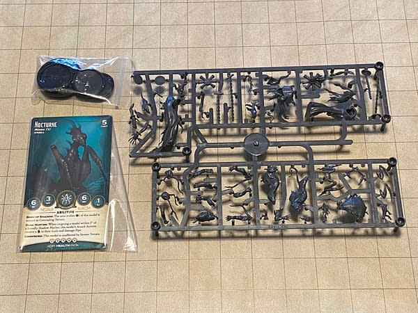 An array of the components for the Dark Reflections boxed set for Wyrd Miniatures' objective-based skirmish wargame, Malifaux. Note the break near the top-left of the sprue.