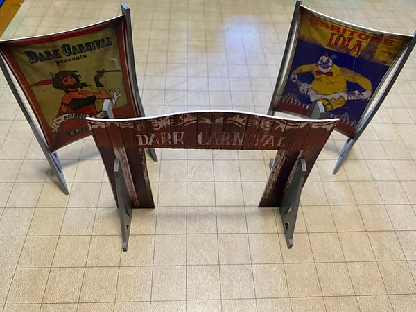 The completed archway entrance and signs for the Circus Entrance boxed terrain set by Wyrd Miniatures and Plastcraft.