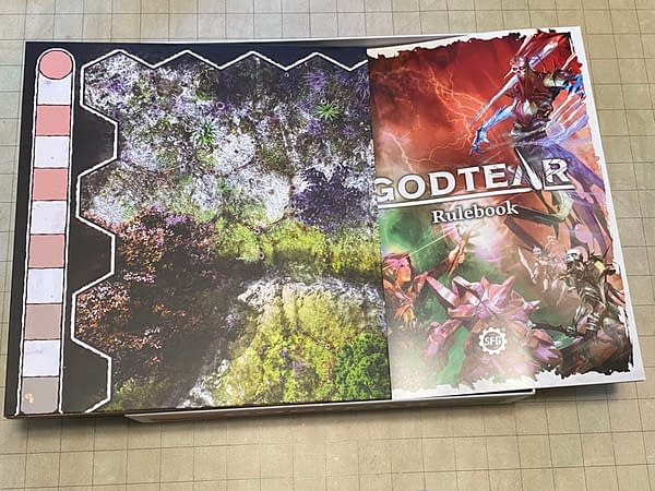 The sturdy game board and rulebook for the Godtear: Eternal Glade starter set by Steamforged Games.