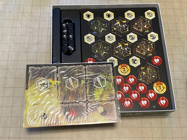 A variety of counters and tokens for Godtear, included in the Eternal Glade starter set by Steamforged Games.