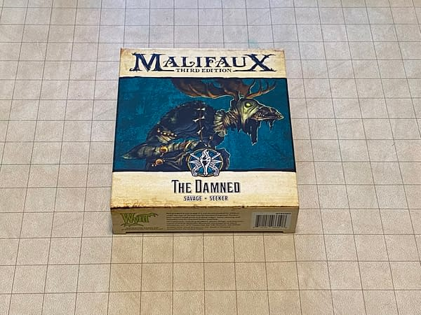 The front of the box for The Damned, a miniature for the objective-based skirmish game known as Malifaux Third Edition, by Wyrd Miniatures.