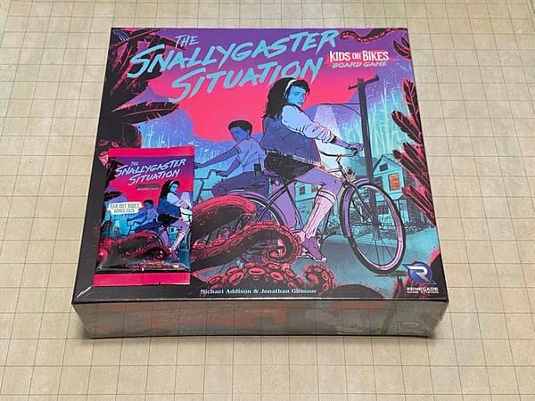 The front of the box for The Snallygaster Situation, a board game by Renegade Game Studios based on the Kids on Bikes RPG.