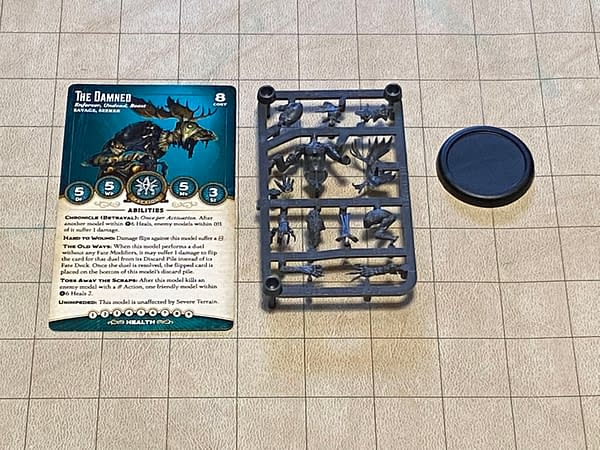 The array of components within the kit box for The Damned, a miniature for Malifaux, a game by Wyrd Miniatures. Note the 40mm base for scale.