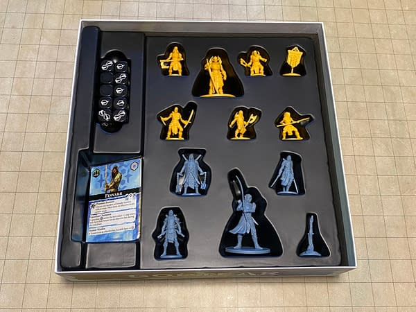 The miniatures, dice, and stat cards for Godtear's starter set The Borderlands, by Steamforged Games. Note the bend in the sword for the champion on the bottom, Finvarr.