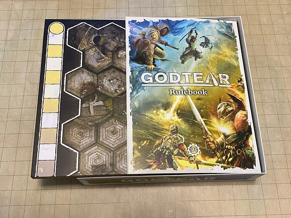 The core rulebook for Steamforged Games' tabletop board game Godtear, as well as the game board for this game.