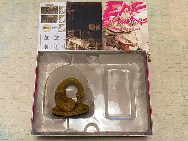 """An array of the contents within Epic Encounters' latest module boxed set, """"Temple of the Snake God"""", by Steamforged Games."""