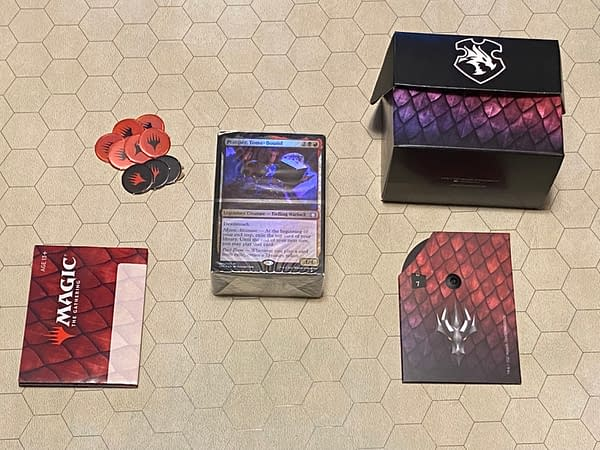"""An array of the contents of """"Planar Portal"""", the Commander deck coinciding with Adventures in the Forgotten Realms, an expansion set for Magic: The Gathering."""