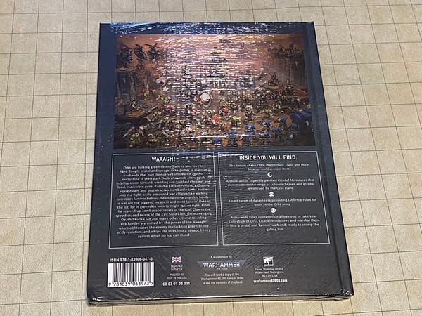 The back cover of the Orks codex from the latest edition of Warhammer 40k, the quintessential grimdark sci-fi tabletop wargame by Games Workshop.